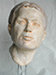 plaster cast of a portrait of a young man in clay